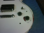 White Painted Guitar After Close-Up